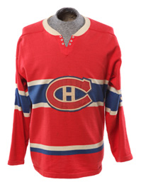 Number 7 artifact in the Original Hockey Hall of Fame collection - Maurice Rocket Richard number 9 Montreal Canadiens jersey